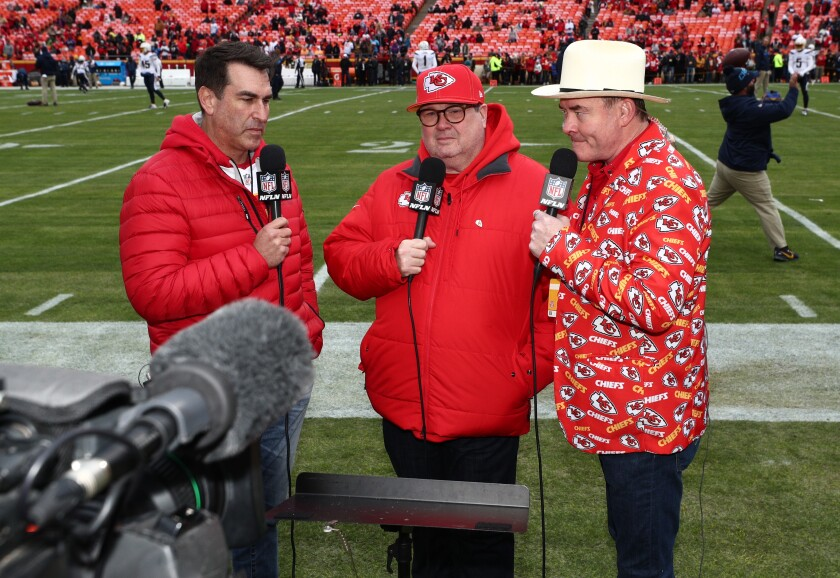 Kansas City fans and actors, from left, Rob Riggle, Eric Stonestreet and David Koechner stand on the sideline before a Chiefs game against the Chargers on Dec. 29 at Arrowhead Stadium.