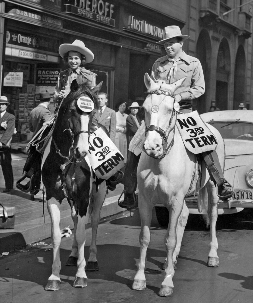 "Oct. 23, 1940: Frances Voltz and Les Sachs ride down Spring Street during ""No Third Term Day"" observances in Los Angeles."