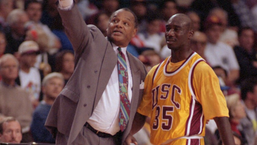 USC basketball Coach George Raveling, left, speaks with freshman Stais Boseman during a game against California in March 1994. Raveling was elected into the Basketball Hall of Fame on Saturday.
