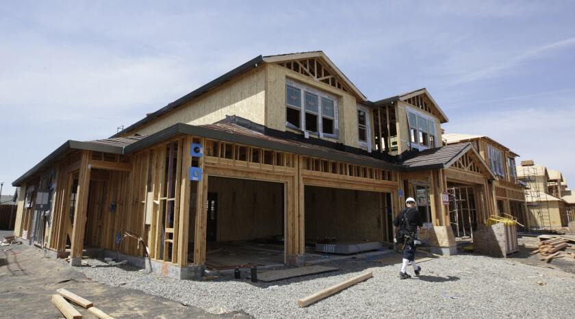 FILE - This May 4, 2018 file photo shows a house under construction in Roseville, Calif. California'