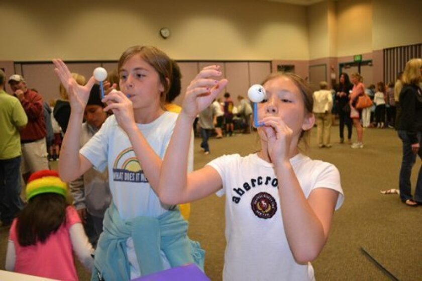 """Mariel Alexander and Natalie Nguyen learned about """"Bernoulli's principle."""" Formulated by Swiss scientist Daniel Bernoulli, the physics principle states that as the speed of a moving fluid (liquid or gas) increases, the pressure within the fluid decreases."""