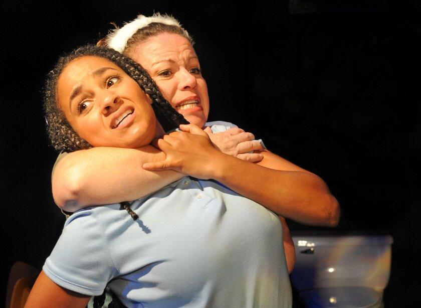 "Rory Lipede (left) and DeAnna Driscoll in Diversionary Theatre's ""when last we flew."""
