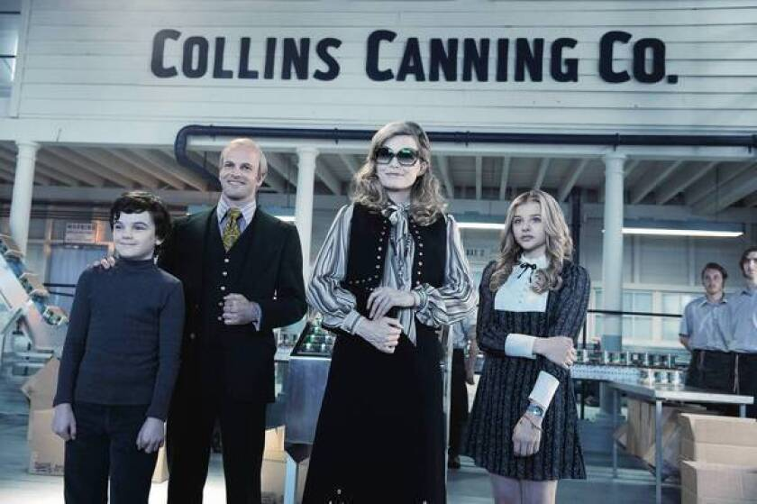 """Colleen Atwood brought classic 1970s looks to the wardrobes of the """"Dark Shadows"""" cast, including Gully McGrath, left, Jonny Lee Miller, Michelle Pfeiffer and Chloë Grace Moretz."""