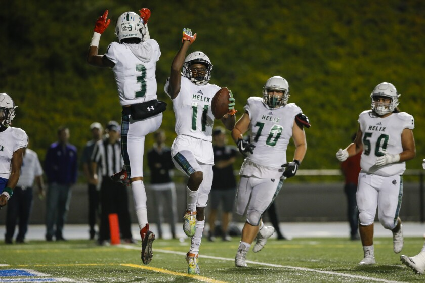 Helix wide receiver Keionte Scott (11), who has 33 receptions for 544 yards and 10 touchdowns, will try to get open Saturday night against the Carlsbad defense.