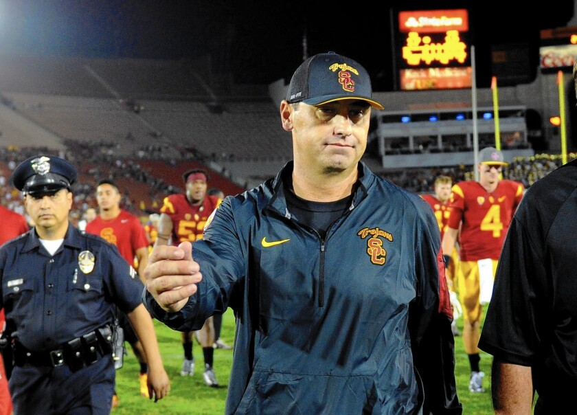 USC Coach Steve Sarkisian walks off the field after losing to Washington at the Coliseum.
