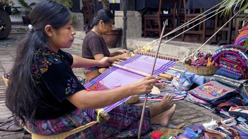 Mayan weavers using a backstrap loom