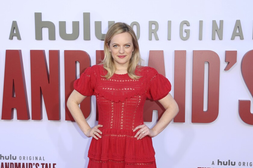 """FILE - In this Tuesday, Aug. 6, 2019, file photo, Elisabeth Moss attends the """"The Handmaid's Tale"""" season three finale red carpet at the Regency Village Theatre, in Los Angeles. The drama series' fourth season begins April 28, 2021, and will include 10 episodes. (Photo by Willy Sanjuan/Invision/AP, File)"""