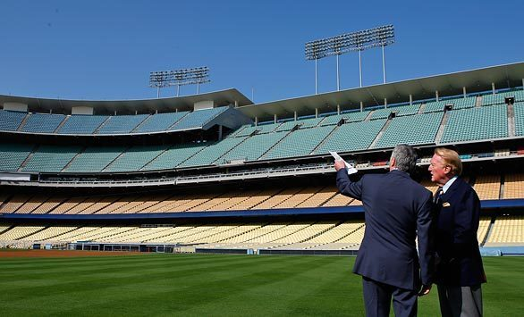 Los Angeles Dodgers announcer Vin Scully, right, talks with team owner Frank McCourt before McCourt unveiled a multifaceted stadium improvement plan at a press conference Thursday.