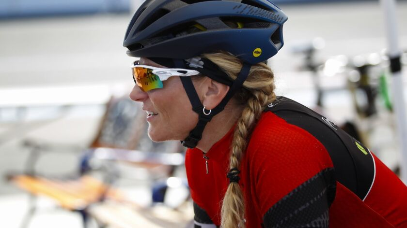 Taking a brief break during a recent morning workout at the San Diego Velodrome, Denise Mueller-Korenek currently holds the women's world paced bicycle speed record of 147.7 mph.