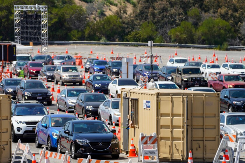 Cars line up at a COVID19 test site at Dodger Stadium on Aug. 12.