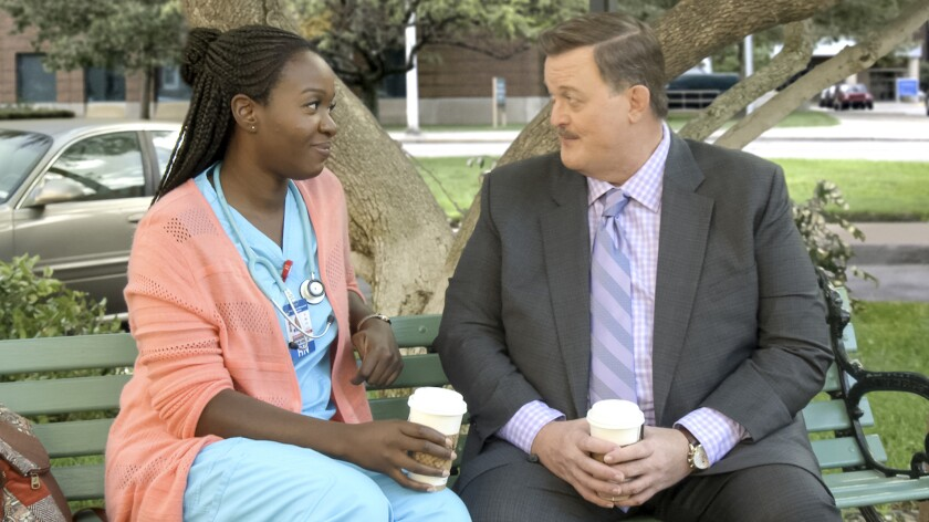 "Folake Olowofoyeku and Billy Gardell in ""Bob Hearts Abishola"" on CBS."