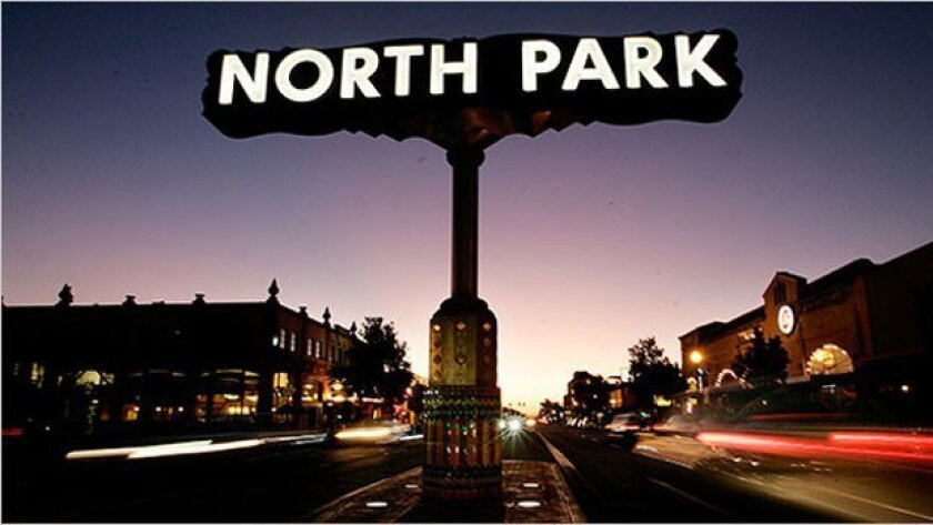 The North Park sign shines over the intersection of 30th & University