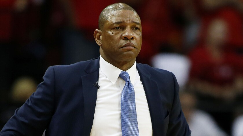 Clippers coach Doc Rivers looks on during a game.