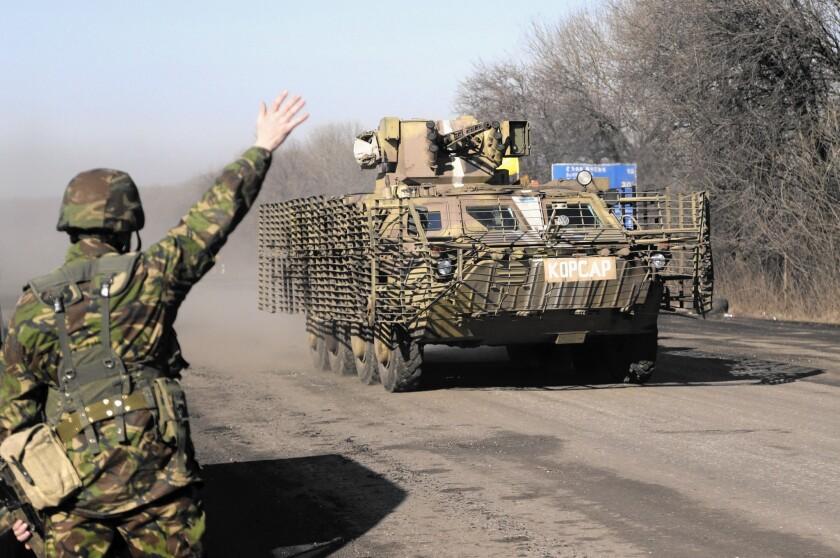 Ukrainian troops move toward Debaltseve in eastern Ukraine on Feb. 13.