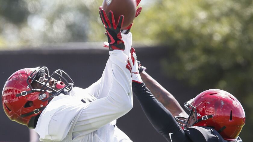 Aztecs wide receiver Kobe Smith catches a touchdown pass by Carson Baker under coverage from cornerback Darren Hall in the second half.