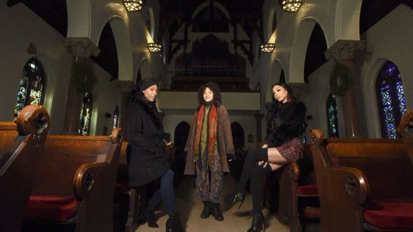 """Trans actors, from left, Mj Rodriguez, Indya Moore and Alexia Garcia at St. Peter's Episcopal Church in the Bronx, where their film, """"Saturday Church"""" was shot."""