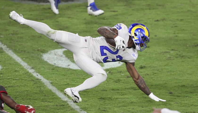 Rams running back Cam Akers stretches for more yardage.