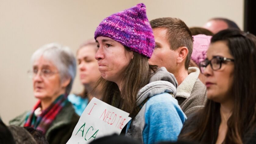 A woman at a town hall meeting held by Rep. Ami Bera laments the possible loss of her family's ACA coverage in Elk Grove, Calif. (Autumn Payne / Associated Press)