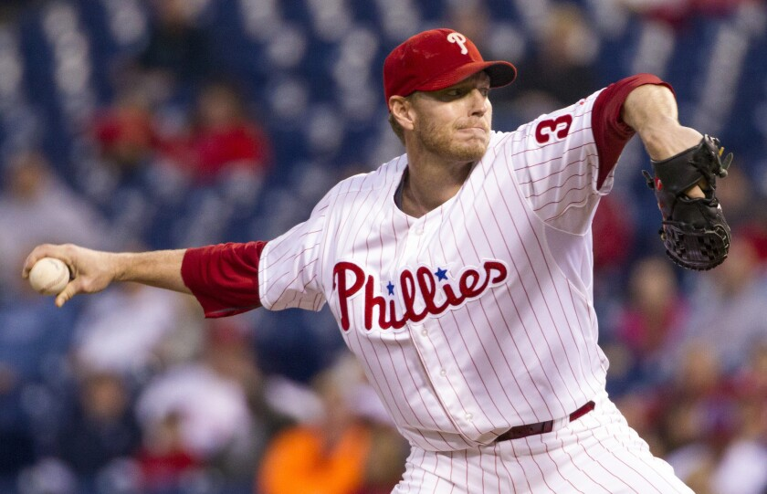 Roy Halladay pitches for the Phillies in 2013.