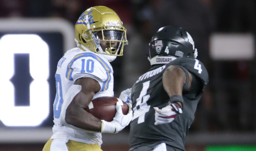 UCLA's Demetric Felton and Washington State's Marcus Strong in a football game.