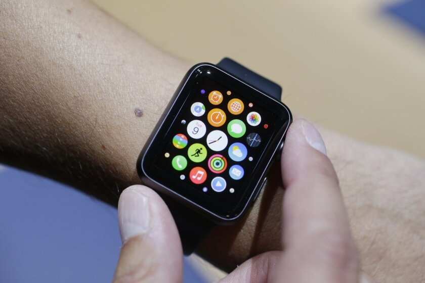 FILE - In this Sept. 9, 2014 file photo, the new Apple Watch is modeled during a media event in Cupertino, Calif. Apple CEO Tim Cook has hinted the wearable gadget will be as game-changing as Apple's revolutionary iPhones and iPads, which have become indispensable accessories for millions around th