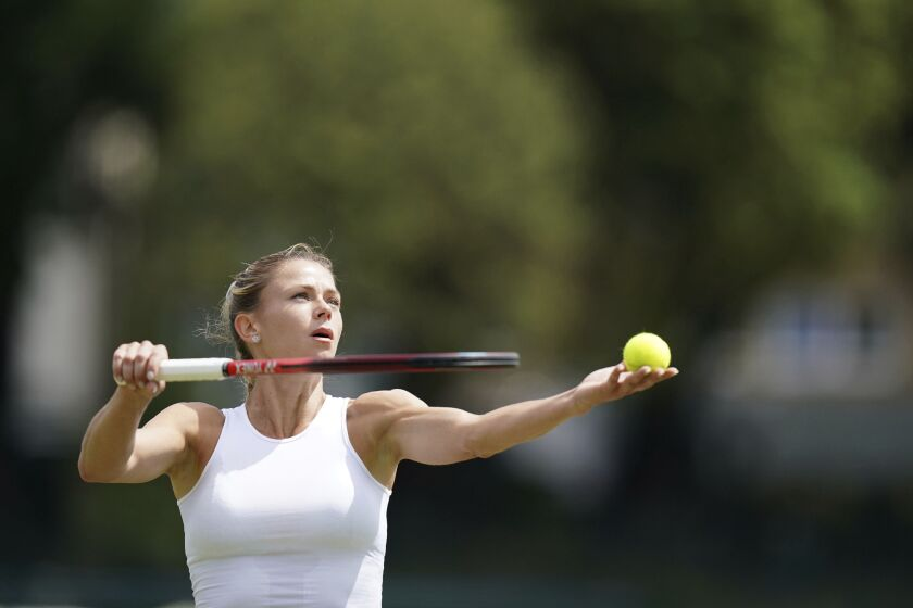 Italy's Camila Giorgi in action against Shelby Rogers during day five of the Viking International tennis tournament at Devonshire Park, Eastbourne, England, Wednesday June 23, 2021. (Gareth Fuller/PA via AP)