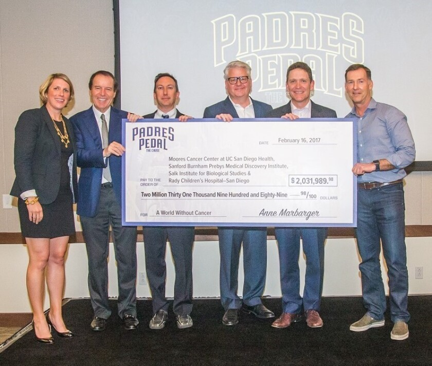 Padres Pedal the Cause presents a check to its beneficiaries.