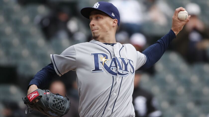 FILE - In this April 10, 2018, file photo, Tampa Bay Rays starting pitcher Blake Snell delivers duri