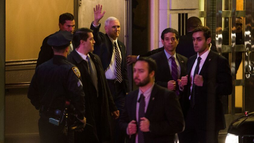 "Vice President-elect Mike Pence, top center, leaves the Richard Rodgers Theatre after seeing ""Hamilton"" on Friday in New York."