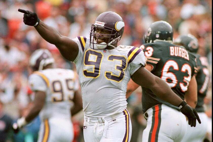 FILE - In this Aug. 15, 1996, file photo, Minnesota Vikings' John Randle celebrates and points at his teammates on the sidelines after disrupting a key fourth quarter pass by Chicago Bears' quarterback Erik Kramer, in Chicago. From a sackmaster defensive tackle to a do-everything running back, the list of the NFL's greatest characters, numbers 31-100, is impressive. Pro Football Hall of Famer John Randle, who retired with the most sacks for his position of anyone, came in at No. 30, one spot in front of the always-entertaining and sometimes out of control Terry Bradshaw. (Jeff Wheeler/Star Tribune via AP, File)