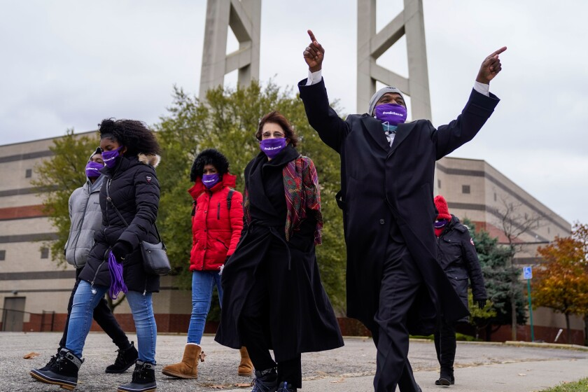 Don Tugwell, 65, of Detroit gestures while participating in a Walk the Vote event.
