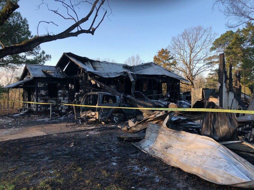 This photo provided by WLBT-TV shows damage to a house after a fatal fire in Clinton, Miss., on Saturday, Feb. 8, 2020. Several people have been killed in the house fire early Saturday in central Mississippi, authorities said. The fire happened around 12:30 a.m. in Clinton, which is outside Jackson, Clinton Fire Chief Jeff Blackledge told local news outlets. The victims, whose names were not immediately released, ranged in age from 1 to 33, Blackledge said. (Reggi Marion/WLBT-TV via AP)
