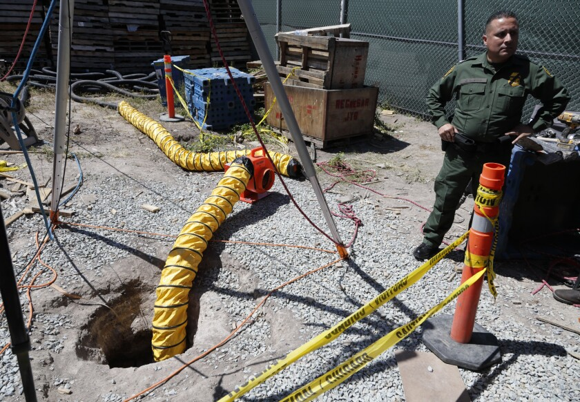Border Patrol Special Operations Supervisor Cesar Sotelo next to the entrance of a tunnel leading to Mexico from a lot along the border, Wednesday, April 20, 2016, in San Diego.