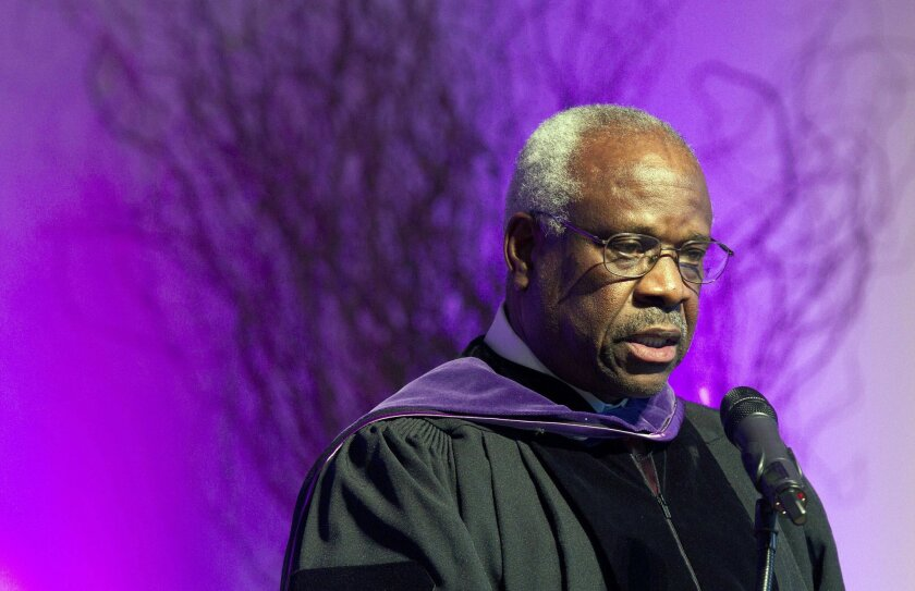 FILE - In this Jan. 26, 2012 file photo, Supreme Court Justice Clarence Thomas speaks at College of the Holy Cross in Worcester, Mass. Thomas has asked questions during Supreme Court arguments for the first time in 10 years. Thomas' question came Monday, Feb. 29, 2016, in a case in which the court
