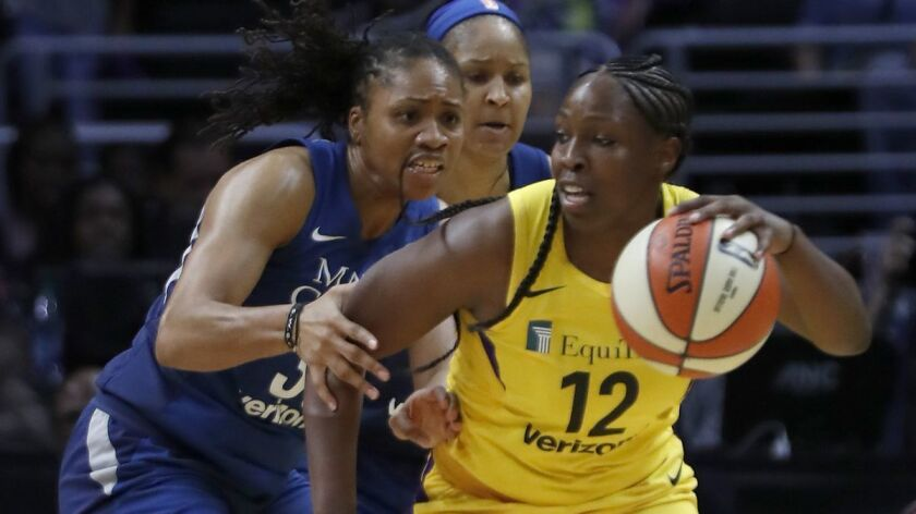 LOS ANGELES, CALIF. - AUG. 21, 2018. Sparks guard Chelsea Gray tries to work through the Lynx defe