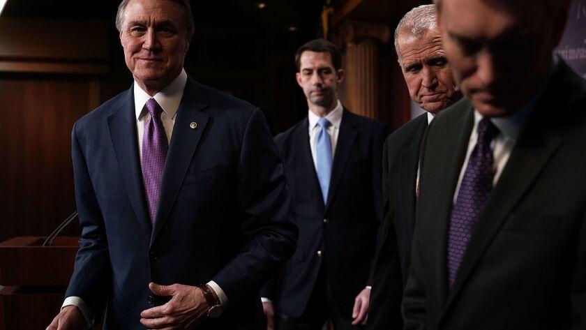 Republican Sens. David Perdue, left, Tom Cotton, Thom Tillis and James Lankford on Capitol Hill.