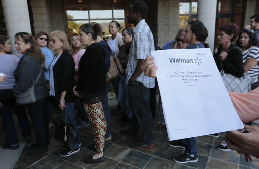 Workers at Wal-Mart's closed Pico Rivera store lined up last Thursday to hear their fate.