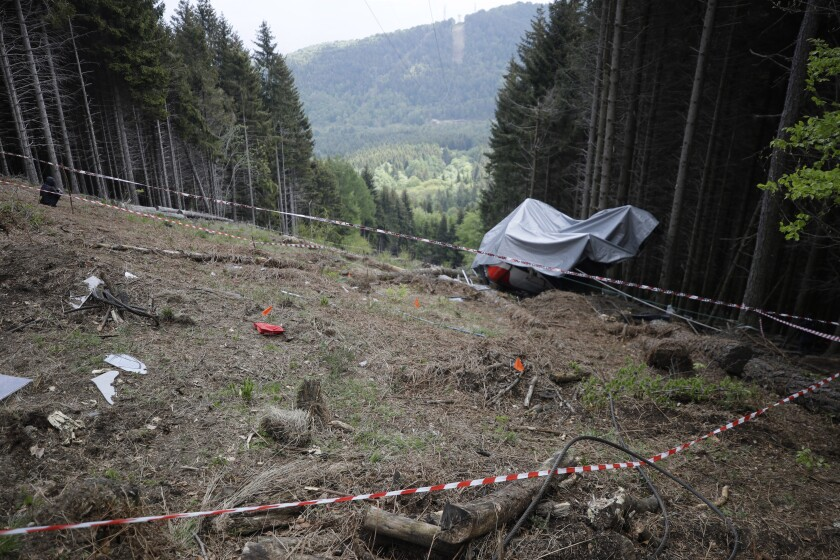 FILE - In this May 26, 2021 file photo, the wreckage of a cable car after it collapsed near the summit of the Stresa-Mottarone line in the Piedmont region, northern Italy. A six-year-old boy who was the sole survivor of a cable car crash this year in northern Italy is at the center of a bitter custody battle between his maternal grandparents in Israel and his paternal relatives in Italy, who claim the child was flown without their permission to Israel over the weekend. (AP Photo/Luca Bruno)