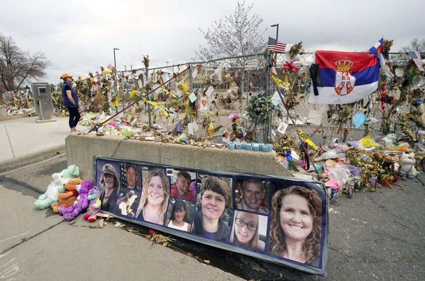 FILE - In this Friday, April 23, 2021, file photo, photographs of the 10 victims of a mass shooting in a King Soopers grocery store are posted on a cement barrier outside the supermarket in Boulder, Colo. Several families and survivors of those killed in the mass shooting at a Colorado supermarket are demanding that a special master be appointed to help distribute public donations for victims to a centralized account, saying the nonprofits currently handling the funds are not giving all of the money directly to victims. (AP Photo/David Zalubowski, File)