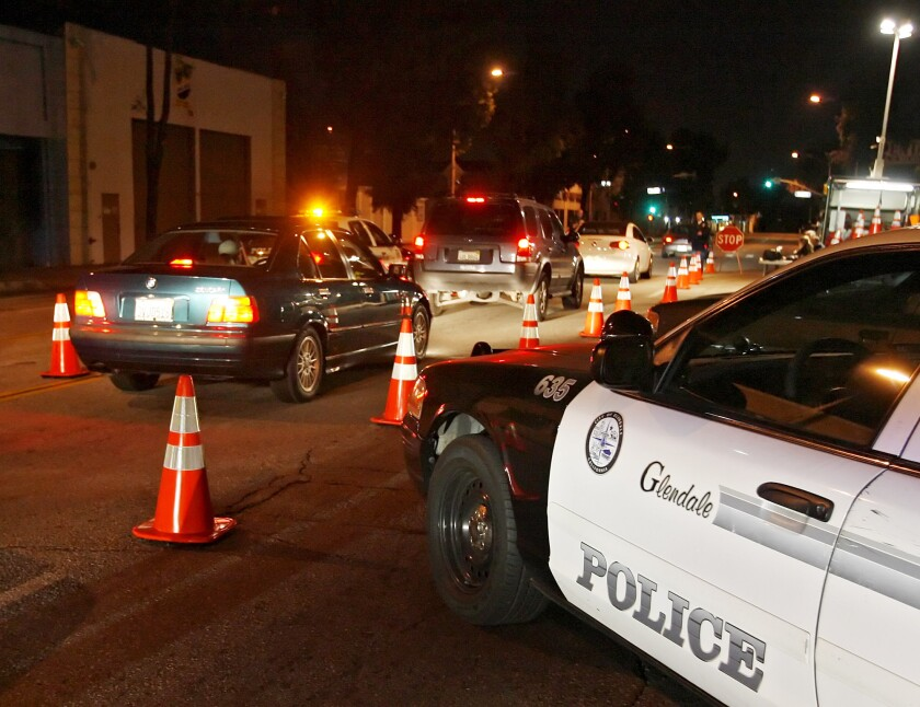 A DUI checkpoint, similar to the one in this file photo from 2010, was held by the Glendale Police Department on Jan. 31 and 12 people were arrested. Only two of the people arrested were suspected of driving under the influence, according to authorities.