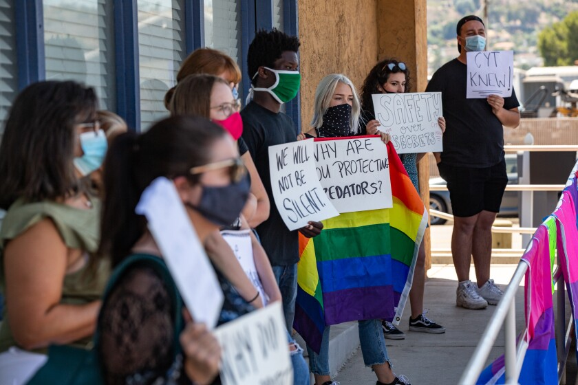 Protesters gathered outside Christian Youth Theater in El Cajon on Friday after a press conference by the theater's president