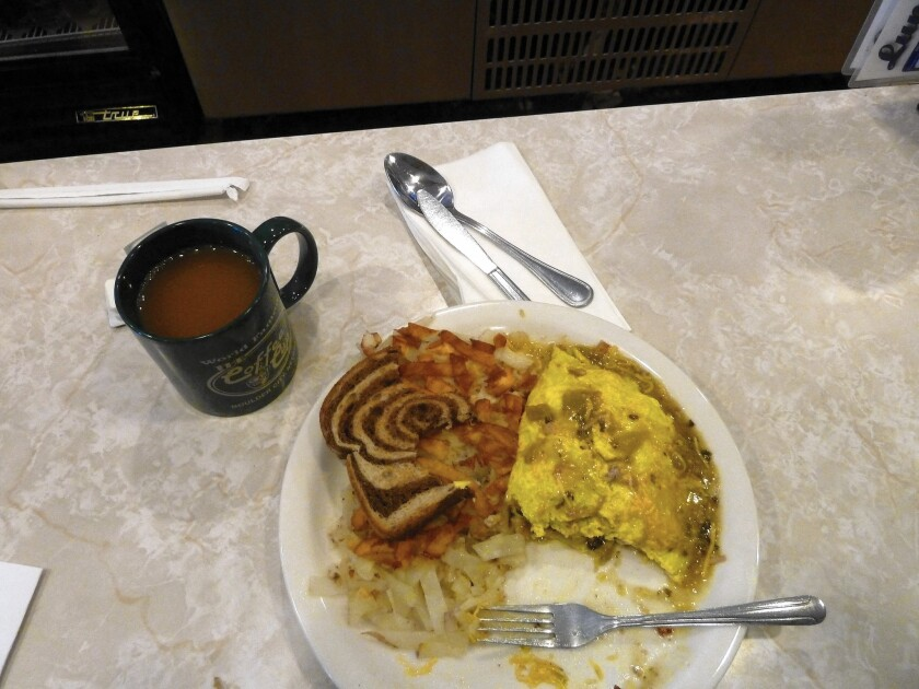 The Coffee Cup breakfast dish made famous by the Food Network, the pork chili verde omelet. It's worth the hype, and then some, a Times staff writer and frequent customer says.