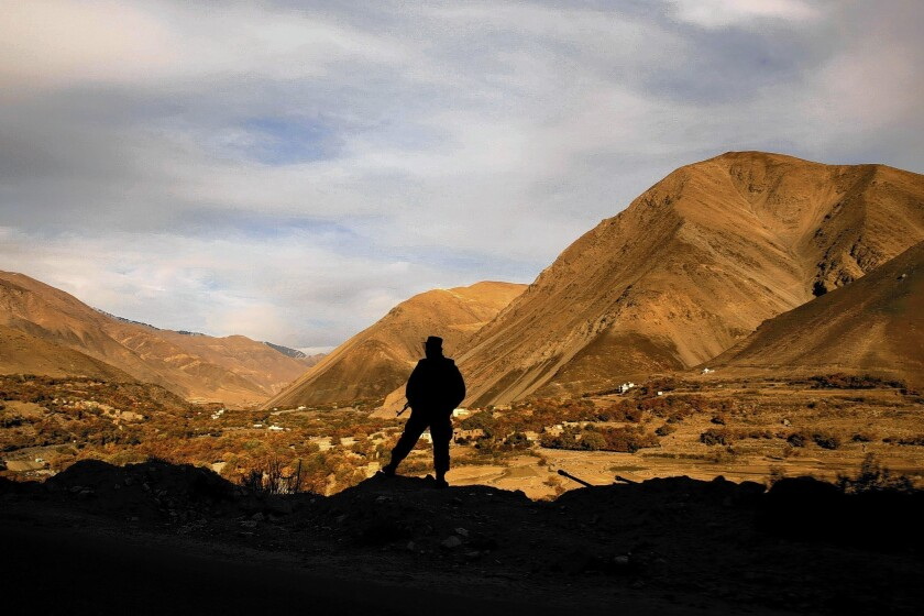 A member of the Afghan army looks out over the Panjshir Valley, in the country's northeast. Panjshir is one of only two provinces never conquered by the Taliban when it ruled Afghanistan.