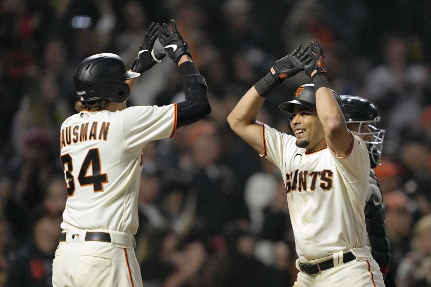 The Giants, including pitcher Kevin Gausman and outfielder LaMonte Wade Jr. have become the surprise of baseball this season.