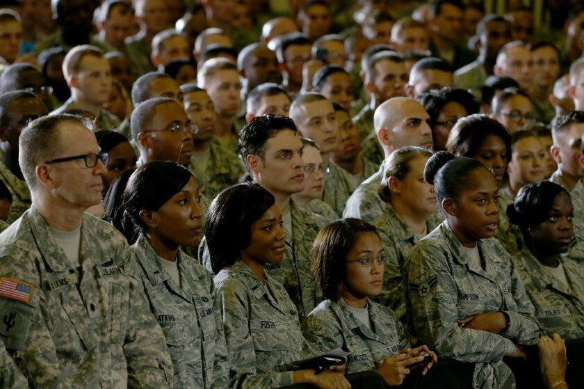 Soldiers listen as President Obama speaks during a visit to the U.S. Central Command in Tampa on Sept. 17.