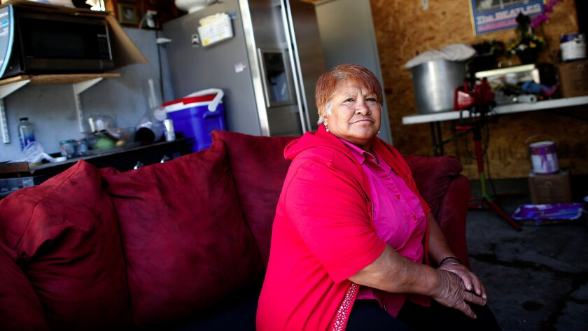 Laura Luevano is one of thousands of L.A. County residents with government-backed rent vouchers who can't find a place to live. She sleeps on a couch on the back patio of a house in Sylmar.