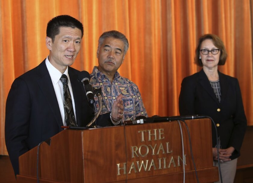Hawaii attorney general Douglas Chin, from left, with Hawaii Gov. David Ige and Oregon attorney general Ellen Rosenblum
