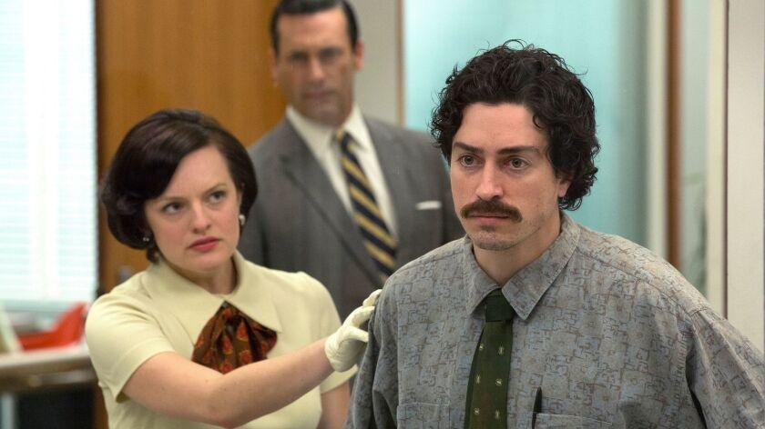 "Ben Feldman as Michael Ginsberg, with Elisabeth Moss as Peggy Olson and Jon Hamm as Don Draper in ""M"