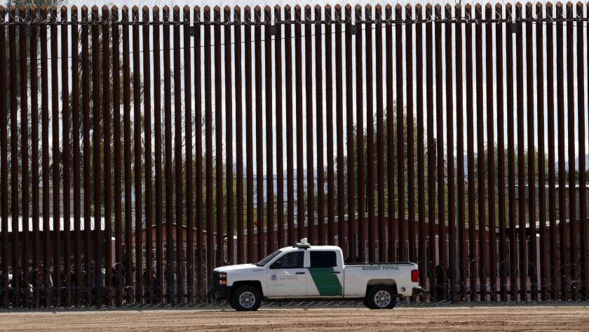 FILE - In this April 5, 2019, file photo, a U.S. Customs and Border Protection vehicle sits near the