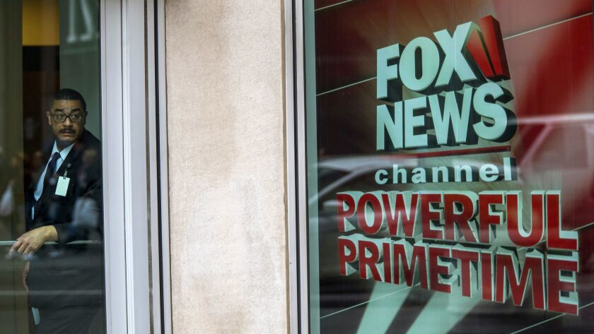A security guard stands at Fox News studios in New York.